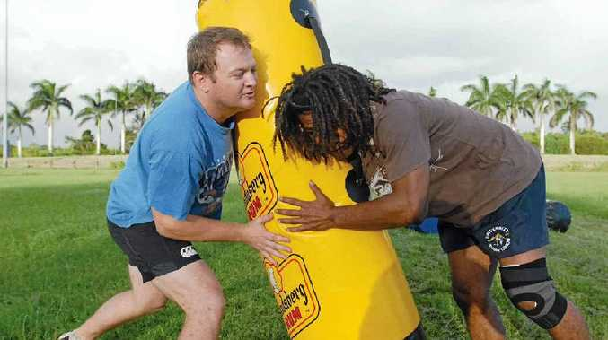 Stingers captain Jono Eather and Usaia Tawakevou hit the training bag ahead of a sevens tournament this weekend.
