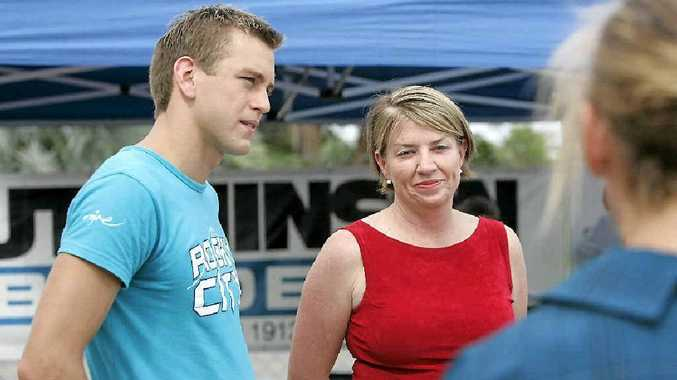 Olympic hopeful Matthew White talks with Premier Anna Bligh at the opening of the city's new championship pool. Matthew took part in an exhibition race with leading swimmers, Alana Bowles, Karleigh Banks and sisters Dahlas and Lana Rogers.