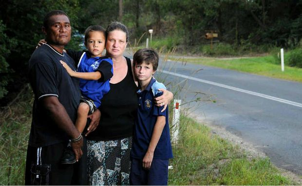 FLOOD TERROR: Manasa Drodrolagi, Jesse, Lisa Steller and Connor were lucky to escape their station wagon after it was swept downstream in fast-moving floodwaters towards a drop (pictured) on Noosa Rd. The family wants people to know the road floods and there are no signs.