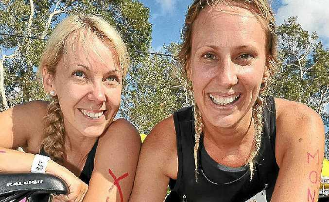 Belle McDonald and Kylie Waugh entered the triathlon to raise funds for Matt Golinski.