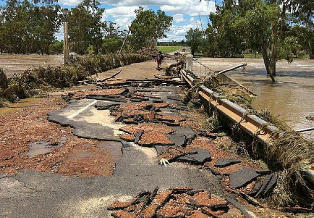 Flood waters have destroyed a bridge in Mitchell.
