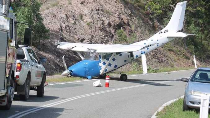 The single-engine aircraft came to a rest against a rock face after an emergency landing on Shute Harbour Rd.