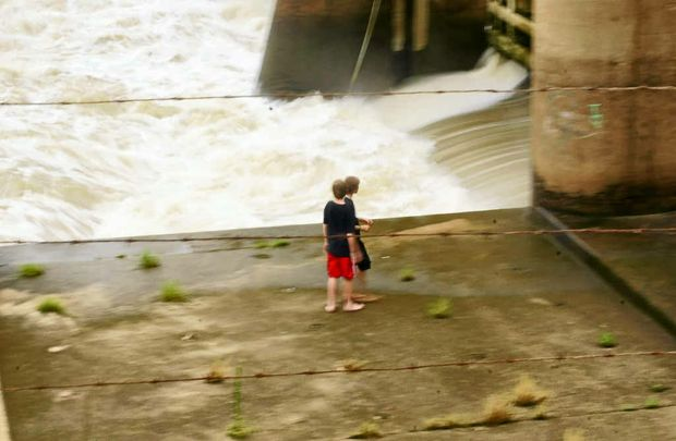 These children are one slippery step away from going over the edge, near the Fitzroy Barrage with fast-flowing water, on Saturday.