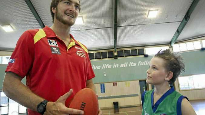 The Cathedral College student Brandon Harrison finds out more about life in the AFL from Gold Coast Suns key forward Charlie Dixon.