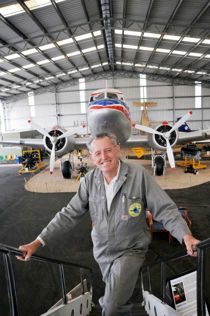 Queensland Air Museum president Cliff Robinson overlooks a DC3.
