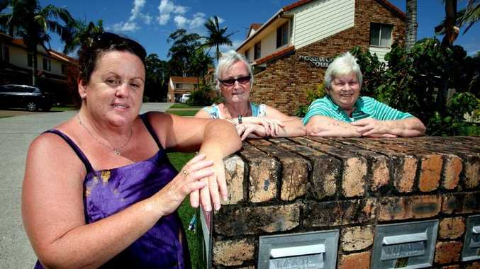 Danielle Woolmer, Brenda Laing and Dot Adams want their complex painted.