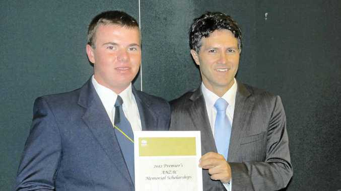 IN MEMORIAM: Local student Justin Keith (left) is a recipient of a 2012 Premier's ANZAC Memorial Scholarship, presented by the Minister for Citizenship and Communities, Victor Dominello.