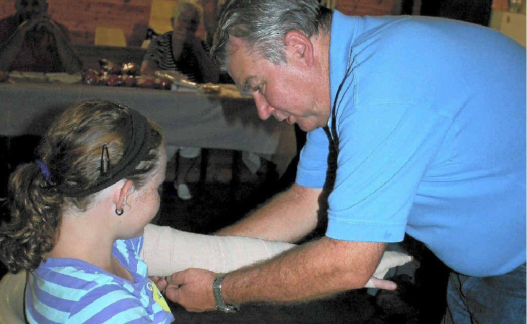 Greg Hardy demonstrates  snake bite bandaging on Linley Doepel at Greymare.