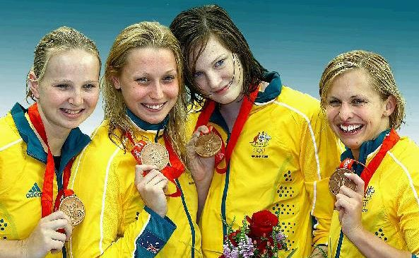 Melanie Schlanger, left, Alice Mills, Cate Campbell and Libby Trickett pose with their bronze medals after Australia's placing in the 100m freestyle relay at the Beijing Olympics.
