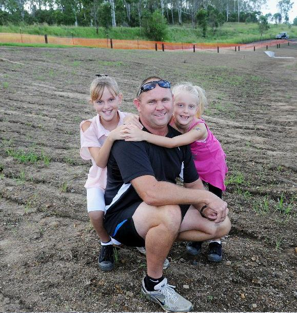 Glenn Warren with daughters Chelsea and Brooklyn on the new bank overlooking Six Mile.