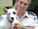 RSPCA regional inspector Alistair Hills with Roxy who is now four-and-half-months old and well on the road to recovery after she was found at Woodenbong tip after being bashed, covered in sump oil and dumped.