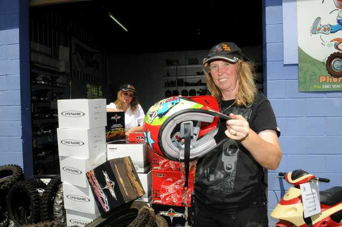 DEVASTATED: Annette Anderson empties a helmet of water. Photo Renee Pilcher / The Gympie Times