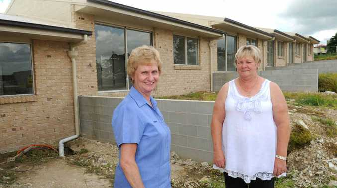 SCIC secretary Mary Brown and committee member Marlene Owen at the units the organisation had built by Hotondo Homes.
