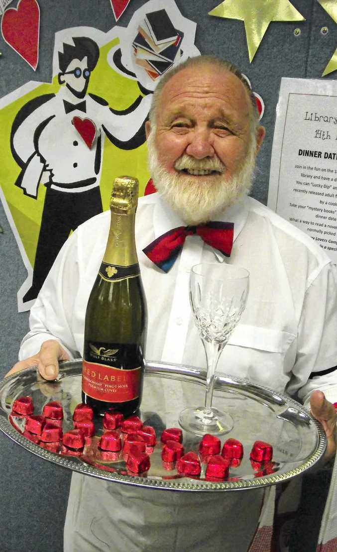 Maitre d' Rae Webb gets ready for this year's Library Lovers Day at Gympie Library.