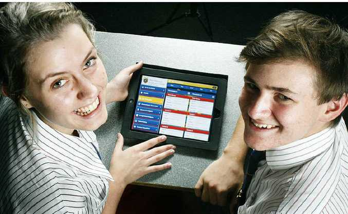 West Moreton Anglican college students Deeann Nutley and Samuel Moxon check out the school's iPad app.