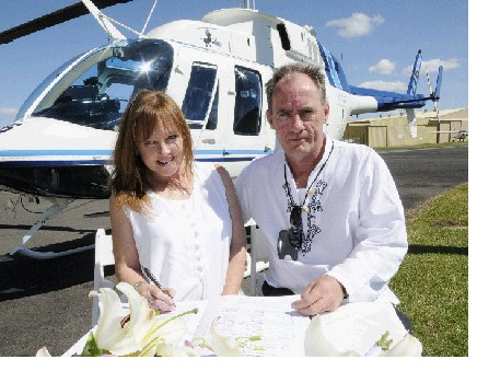Julie and John Hill after they tied the knot the second time, at 500 feet above Byron Bay in a helicopter.