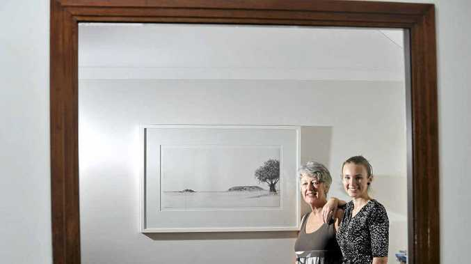 Mother and daughter artists Maggie and Katie Cross prepare for their exhibition opening in Ballina.