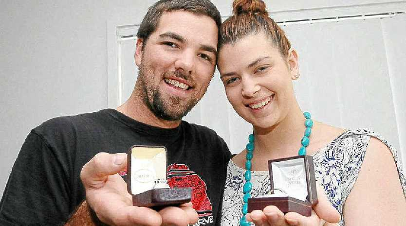 Leticia Hatch and Thomas Commerford show off their bling.