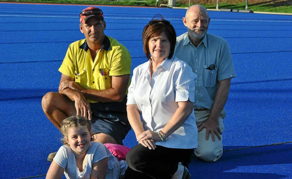 (From left) Junior player Kaycie Gillam with hockey flood committee officials Glenn Eastwell, Sheryl Windle and Peter Pickering during progress work on the new surface.