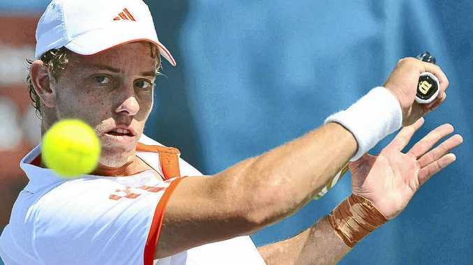 James Duckworth in action against Brydan Klein at the Caloundra International yesterday.