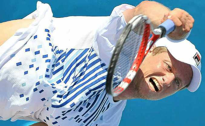 Greg Jones gives it his all as he serves to Taiwan's Yen-Hsun Lu at the Caloundra International yesterday.