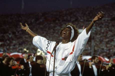 Whitney Houston sings the National Anthem before a game with the New York Giants taking on the Buffalo Bills prior to Super Bowl XXV at Tampa Stadium on January 27, 1991 in Tampa, Florida.