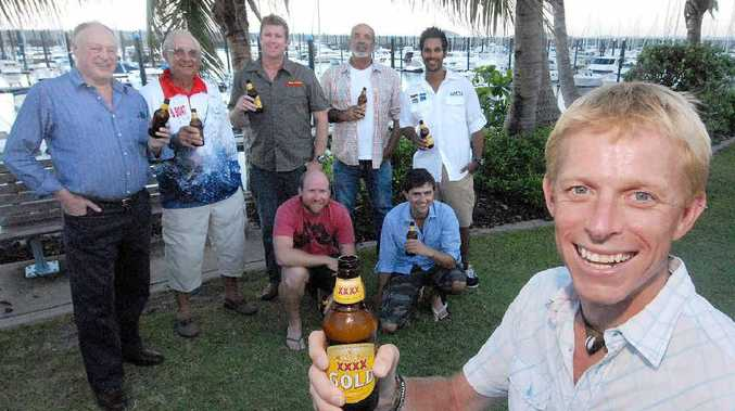 Ben Southall toasts the good fishing in Queensland at Mackay Marina yesterday with (back from left) Mackay Tourism general manager David Phillips and journalists John Mondora, Ben Collins, Bruce McMahon, Justin Felix, Ben Groundwater and Matt Smith.