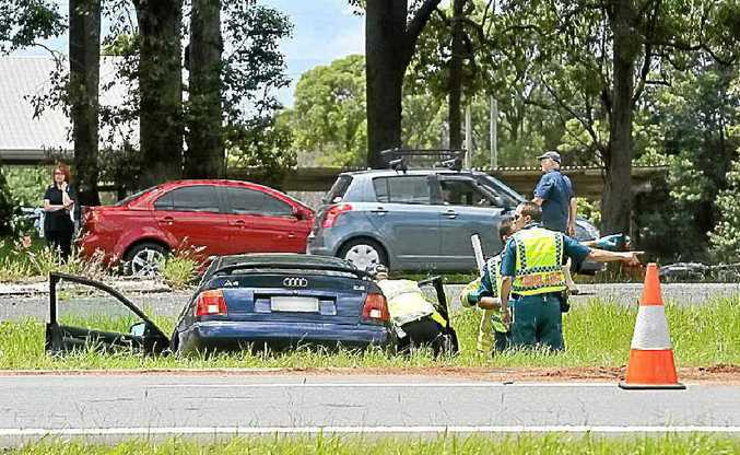 LUCKY ESCAPE: The scene of the car crash on the Bruce Hwy.