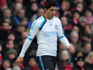 Striker Suarez's bite could see him booted from Liverpool