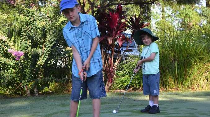 JUNIOR GOLFERS: Jordan Coates, 10 of Evans Head and Jonah Lancaster, 6 of Tabbimoble warm up for some lessons on golf at the Woodburn Evans Head Golf Club. Photo Samantha Elley / Rivertown Times