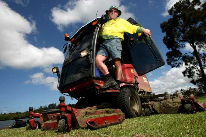 Jimmy Smith cutting the grass in the Tweed.