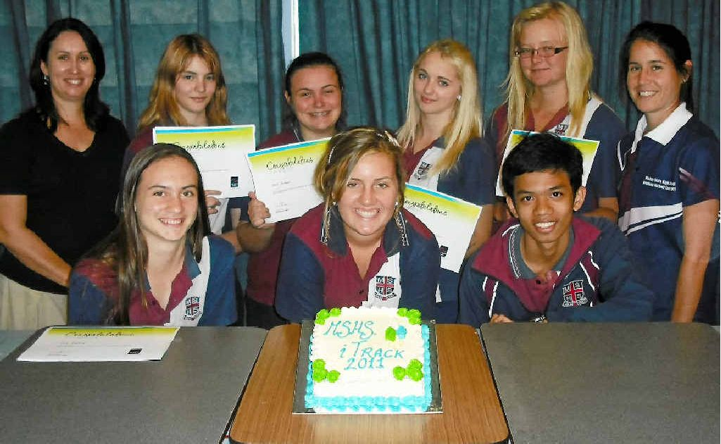 Celebrating the successful completion of the iTrack program are, from back left, Wendy Gernhoefer (Learning for Life worker/The Smith Family) Courtney Spratt, Darcie Beckmann, Courtney Brooker, Samantha Plath, Carynne Robinson (MSHS iTrack facilitator); front, Chloe Bradford, Stephanie McBride, Mark Bien Bico.