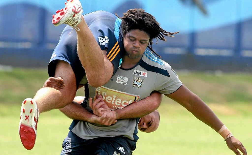 Gold Coast recruit Jamal Idris picks up fellow Titan Matt White. Mackay fans hope that Idris will take on the Cowboys this weekend after making his first appearance for the Titans.