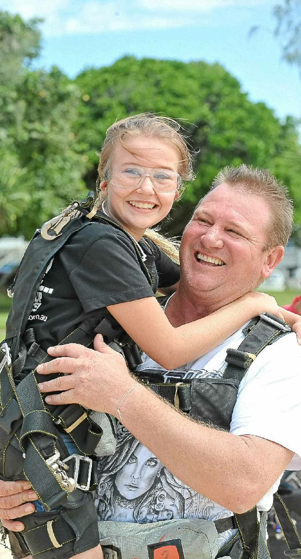 Rob Atkinson gives his daughter Shianne a hug after her tandem skydive.