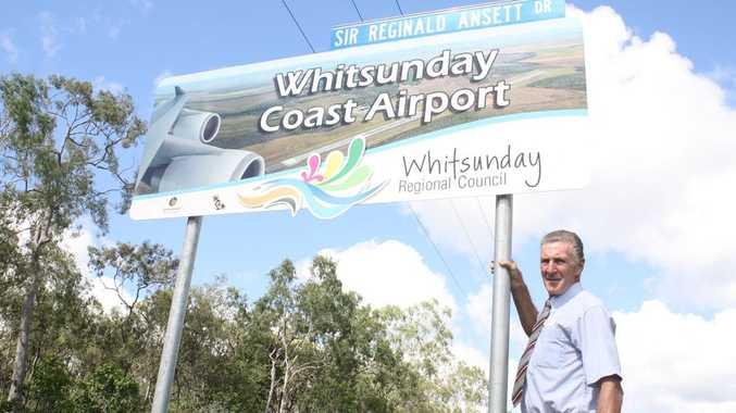 Whitsunday deputy mayor Cr Rogin Taylor with the new Sir Reginald Ansett Dr sign.