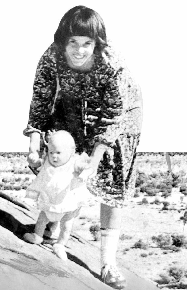 TRAGIC PAST: A photo, taken in August 1980, shows Lindy Chamberlain holding her daughter Azaria on Uluru (Ayers Rock) in the Northern Territory.