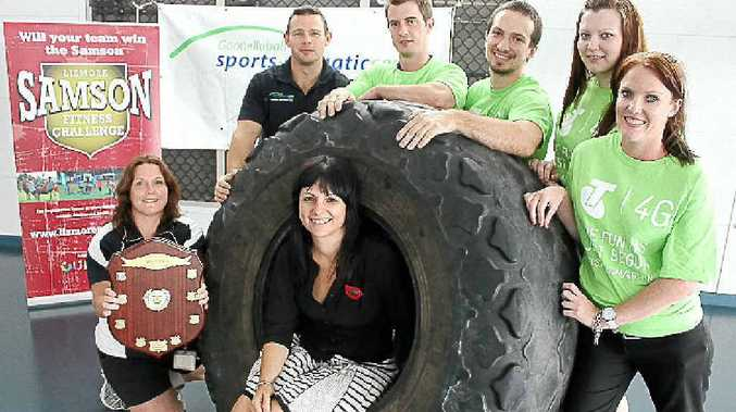 Rebekka Battista from Our Kids (in the tyre) with (l-r) Julie Speidel from last year's winning team, the GSAC Gladiators, Jason Clarke from Team Samson, James Piccoli from the Telstra Titans, Daniel Mulcahy from the Telstra Twinkle Toes and Nakaia Darvill and Elyse Price from the Telstra T-Units.