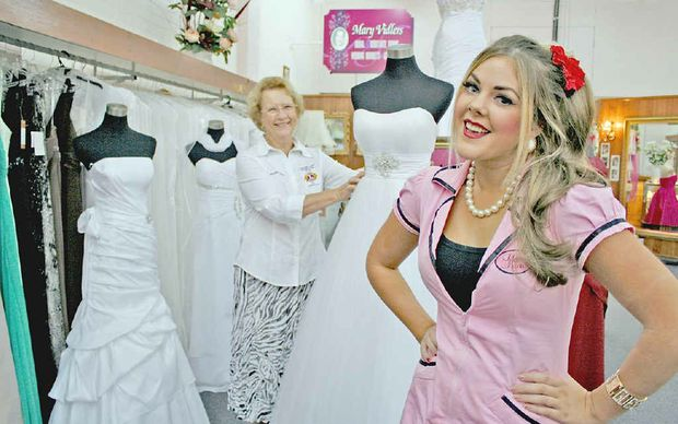 Miss Personality Beth Power (right) and Lismore Lions Club president Maureen Davy showing off some of the dresses brides can choose from if they win the raffle at the fundraising bridal expo.