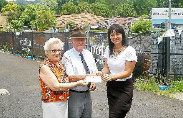 Lola and Ray Ingram from the Lismore Uniting Church Regional Mission Breakfasts with Rebekka Battista, Our House director, in front of the Our House construction site in Hunter Street, Lismore.