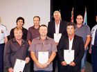 Assistant Commissioner Steve Gollschewski (far left) and Supt Andrew Morrow (far right) present awards to residents (front, from left) Warren McErlean, Peter Van Den Elsen, Christopher Forden, (back from left) Iain Gray, Chris Skehan, Allan Payne and James Wilkin at the Queensland Police Exemplary Awards.