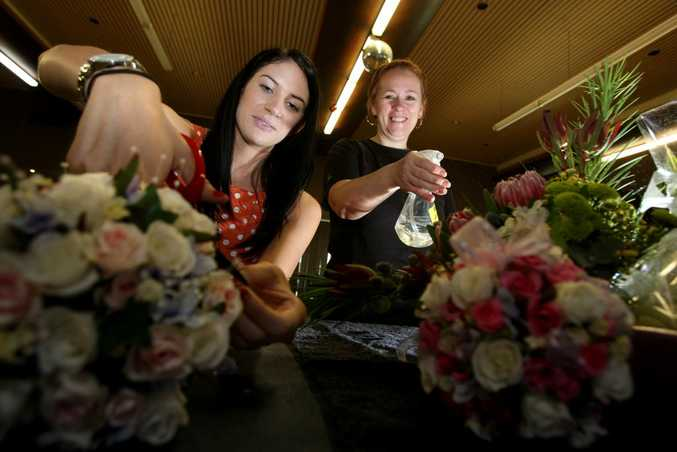 Emma Ferrari applies some floristry skills taught to her by Joanne Groombridge.