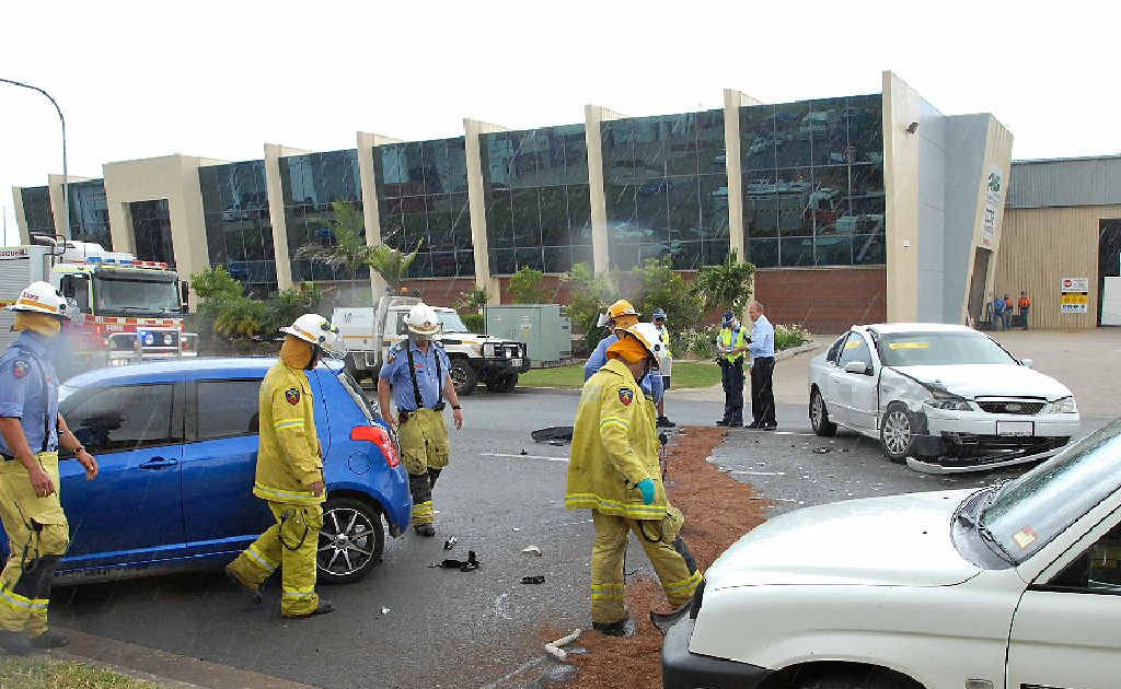 Emergency personnel clean up after a three-vehicle crash at Paget. Two women were taken to hospital and a third car was damaged as a result of the collision.