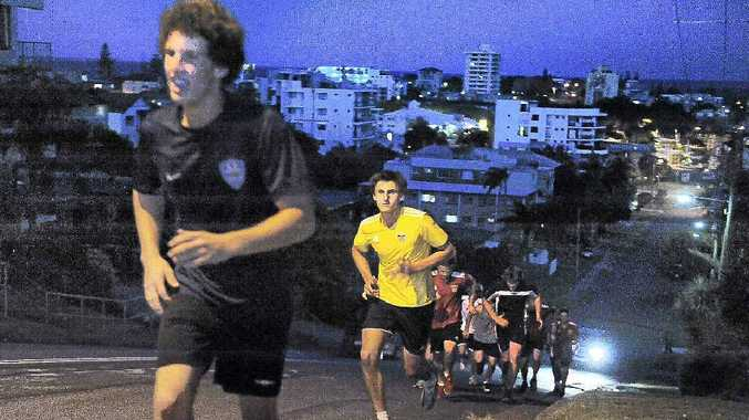 The Sunshine Coast Fire players do their annual Arthur Street hill run.