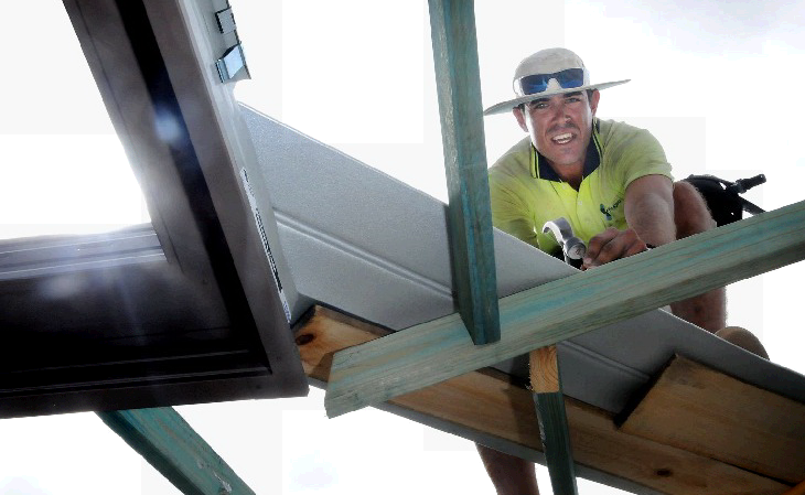 ON THE WAY UP: Lee Vieritz of the Stoddart building group works on a new Gympie home. Photo Renee Pilcher