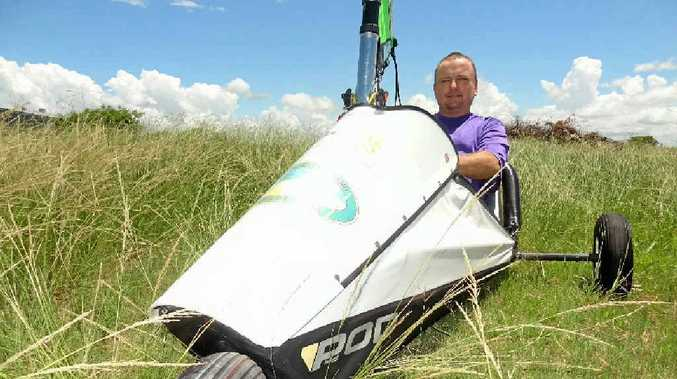 Darren Bianchi sits in his blokart on land which will soon become a race track for the land yachts.