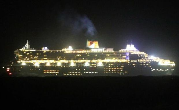 Queen Mary 2 cruises past Pt Cartwright about 10pm on Thursday night. Picture:  Ian Ward