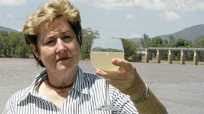 Cr Glenda Mather with a sample of Fitzroy River water.