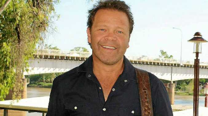 Troy Cassar-Daley on the Rockhampton riverfront yesterday as he stops to say hello while touring the countryside to promote his upcoming new album.