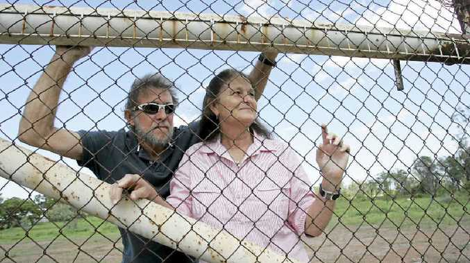 Dennis and Vicki Fry on the land they have been trying to develop for six years.