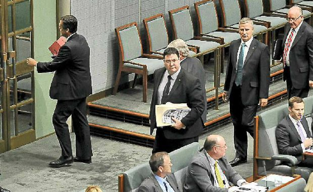 National Party MPs stage a protest walkout over their leader Warren Truss being ejected by the Speaker Peter Slipper (below) during House of Representatives question time yesterday.